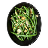 Green Beans with Toasted Almonds in Black Bowl. Green beans with toasted almonds, in black bowl. Isolated on white, top view Royalty Free Stock Photos
