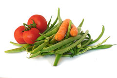 Green beans, tomatoes and carrots Royalty Free Stock Photo