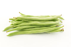 Green beans on white background. Green beans or snap beans on white background royalty free stock photos