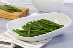 Green beans in white bowl Stock Images