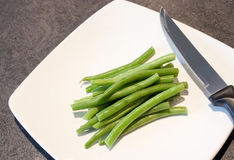 Green beans on a white plate Stock Image