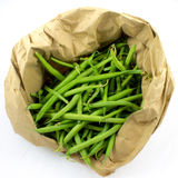 Green beans. Whole green beans in a paper bag stock photography