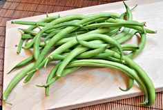 Green beans on wood Stock Images