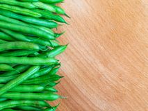 Green beans on wood background. Top view and Copy space royalty free stock photo