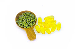 Green beans on wood spoon and healthy cod liver oil. Stock Photo