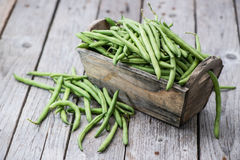 Green Beans on wood Stock Image