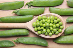 Green beans on wooden background Stock Images