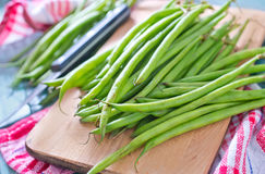 Green beans. On the wooden board Stock Photos