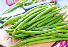 Green beans. On wooden board Royalty Free Stock Image