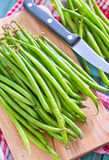 Green beans. On the wooden board Stock Image