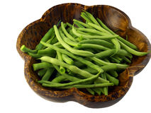 Green Beans in a wooden bowl. Green beans fresh from our garden in a brown wooden bowl, isolated Stock Photo