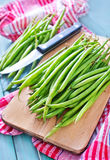 Green beans. On the wooden table Stock Photo