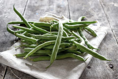 Green Beans. On wooden table, natural light Royalty Free Stock Images