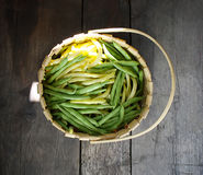 Green beans on a wooden table. Green beans on wooden surface. Close up top view Royalty Free Stock Photos