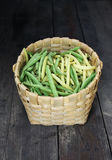 Green beans on a wooden table. Green beans on wooden surface. Close up top view Royalty Free Stock Photography