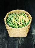 Green beans on a wooden table. Green beans on wooden surface. Close up top view Royalty Free Stock Images