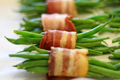 Green beans wrapped in bacon Stock Images