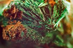 Green beautiful background of natural mineral Malachite. Macro royalty free stock image