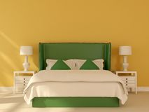 Green bed on a yellow background Royalty Free Stock Images