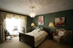Green bedroom. Warm romantic bedroom , painting have benn blured stock photos
