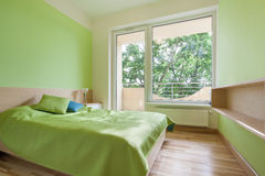Green bedroom in apartment. Horizontal view of green bedroom in apartment Royalty Free Stock Images