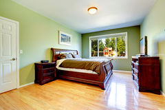 Green bedroom with carved wood furniture Stock Photography