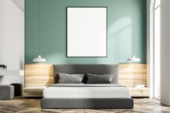Green bedroom interior, frame poster close up. Green bedroom interior with a wooden floor, a king size bed and a frame vertical poster hanging above it. A close Royalty Free Stock Photography