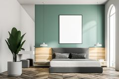 Green bedroom interior, frame poster. Green bedroom interior with a wooden floor, a king size bed and a frame vertical poster hanging above it. 3d rendering mock Royalty Free Stock Photo