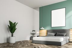 Green bedroom interior, frame poster side view. Green bedroom interior with a wooden floor, a king size bed and a frame vertical poster hanging above it. A side Royalty Free Stock Images