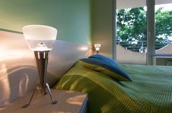 Green bedroom with modern lamps Royalty Free Stock Photography