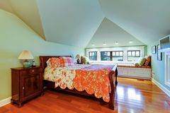Green bedroom with vaulted ceiling and window bench. Stock Photo