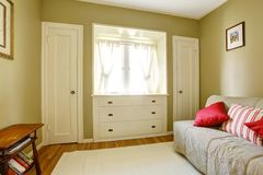 Green bedroom with white doors and dresser. Royalty Free Stock Photos