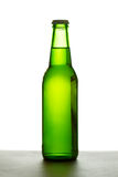 Green beer bottle. Over white background illuminated from the back Stock Photography