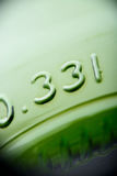Green beer bottle bottom macro shot Royalty Free Stock Photography