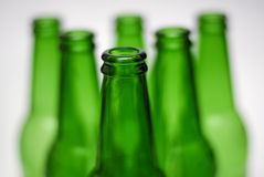Green beer bottle pyramid. Several green beer bottles on white background Stock Photography