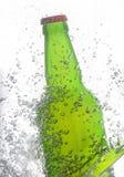 Green beer bottle splash Royalty Free Stock Images
