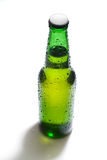 Green beer bottle with water drops Stock Image