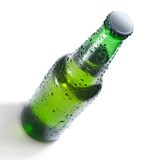 Green beer bottle with water drops Royalty Free Stock Photography