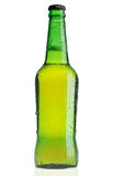Green beer bottle with water drops Royalty Free Stock Images