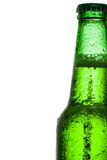 Green beer bottle with water drops over white background Stock Photos