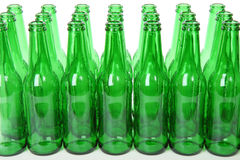 Green Beer Bottles. In three rows on white background Royalty Free Stock Image