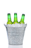 Green beer bottles in a bucket of ice Stock Photography