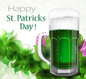Green beer on clover background Royalty Free Stock Image