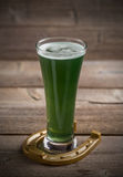 Green beer and horseshoe Royalty Free Stock Photos