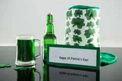 Green beer with shamrock, leprechaun hat and placard of St Patricks Day Royalty Free Stock Photography
