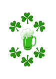 Green beer with shamrocks Stock Photo