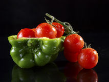 Green Bell Pepper and cherry tomatoes. Stock Photo