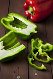 Green bell pepper cut in half and slices stock image