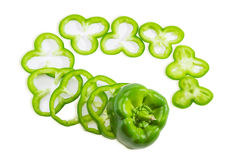 Green bell pepper sliced rings on a light background Royalty Free Stock Photography