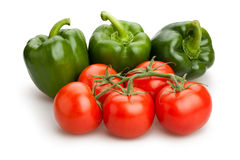 Green bell pepper and tomato Stock Photos